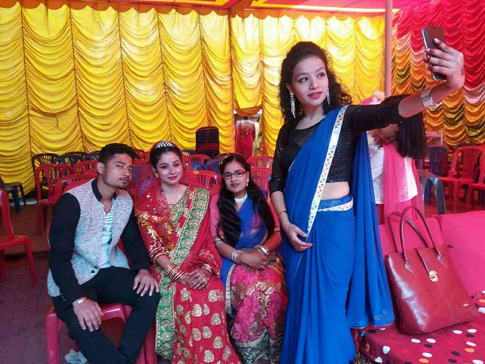BMKF scholar Anisha Gautam takes a photo at her sister's wedding.