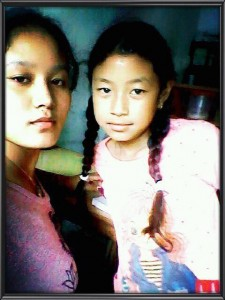BMKF scholar Lhamu Sherpa with her little sister.